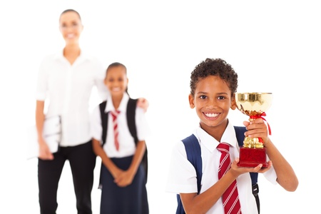 cute schoolboy holding trophy in front of teacher and classmate Stock Photo - 18075375