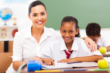 beautiful primary school teacher and students in classroom Stock Photo - 18075618