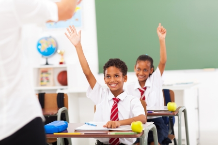 uniform student: elementary school students arms up in classroom