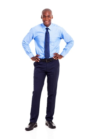 hands on waist: young african american businessman full length portrait isolated on white