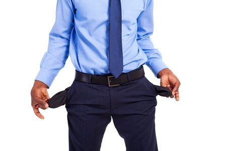 empty pockets: african american businessman with empty pockets Stock Photo