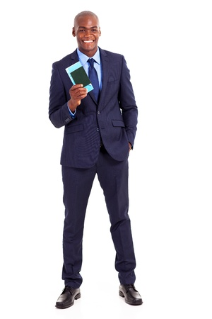 african business traveller with air ticket and passport photo