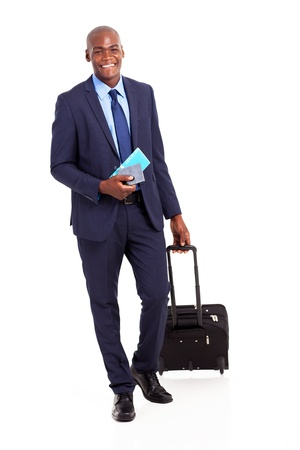 african business traveller with trolley bag and air ticket photo