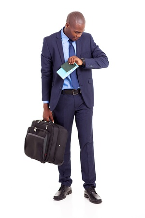 african american business traveller checking flight time photo