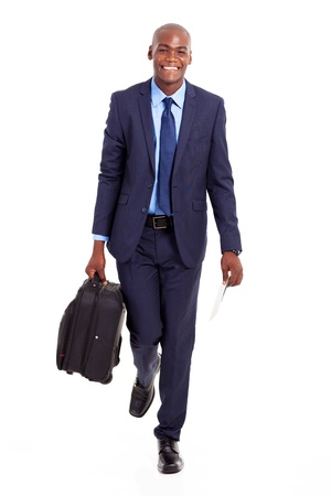 african businessman walking with suitcase isolated on white photo