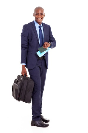 happy african american business traveller with suitcase and air ticket photo