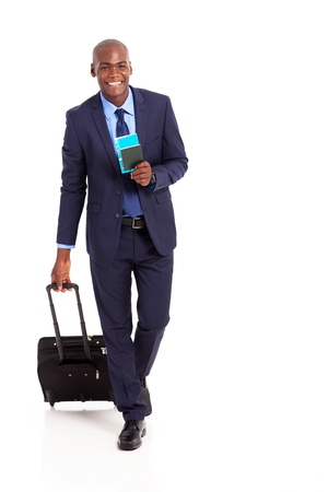 african american business traveller walking on white photo