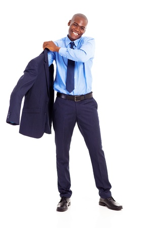 handsome african american businessman putting on jacket on white background photo