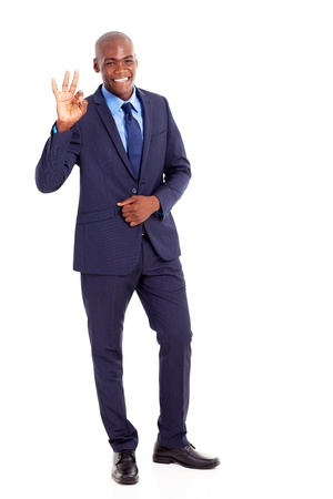 african businessman: black businessman giving ok hand sign