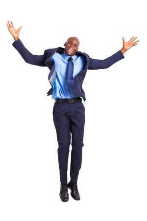 happy african businessman jumping high isolated on white photo