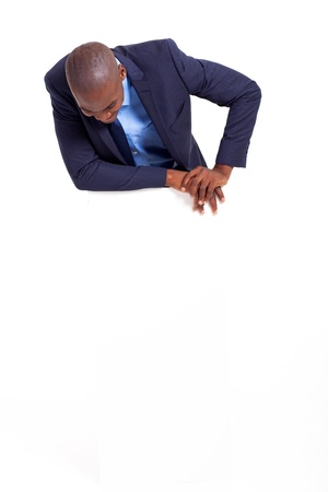 african american business man looking down at empty banner photo