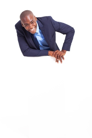 happy african american businessman behind white board  photo
