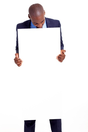 black businessman holding empty banner and looking down photo