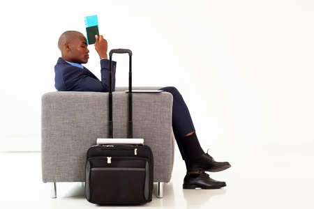 tired african american businessman resting in airport VIP lounge photo