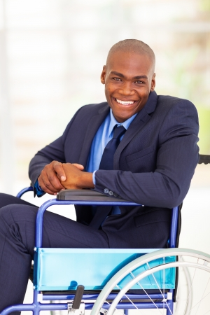 optimistic handicapped african businessman sitting on wheelchair