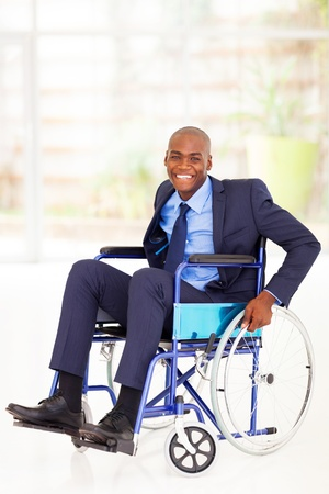 wheelchair: optimistic disabled african american businessman sitting on wheelchair