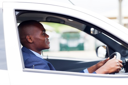 african american businessman driving to work photo