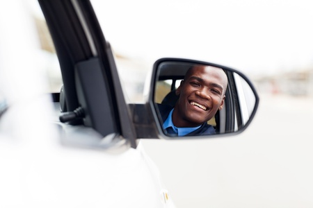 new car: male african american driver looking at rear mirror