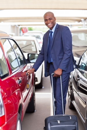 handsome african businessman in airport parking lot photo