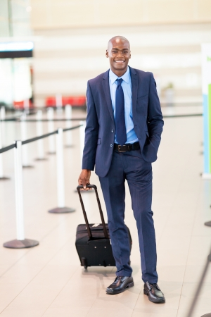 handsome african business traveller in airport photo
