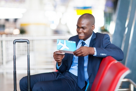 african businessman at airport waiting for flight photo