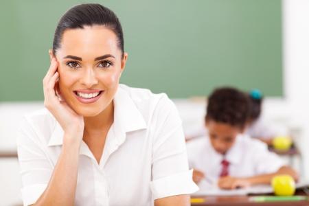 educator: elementary school educator siting in classroom