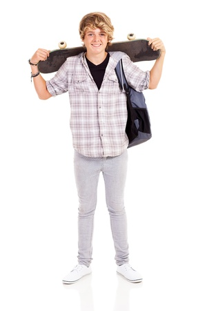 happy teen boy carrying skateboard on his shoulder isolated on white photo