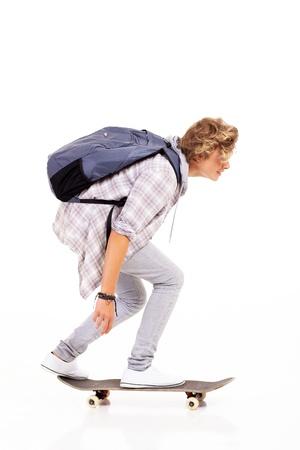 teen boy skateboarding isolated on white Stock Photo - 18578894