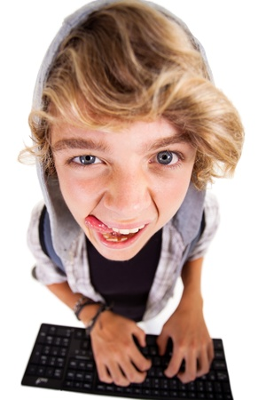 overhead view of a naughty teen boy playing on computer keyboard Stock Photo - 18561914