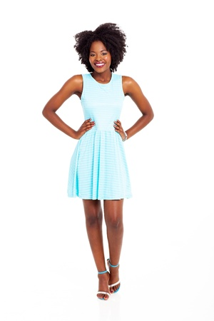 ethnic dress: pretty young black woman in blue dress isolated on white