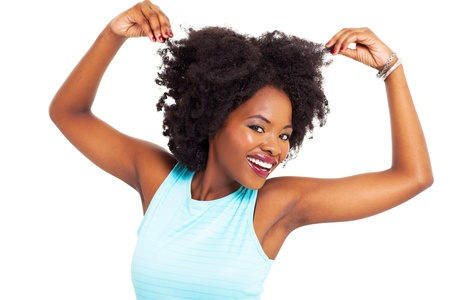 african american woman: funny african woman playing with her hair on white