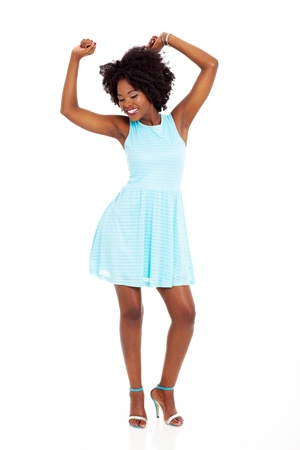 happy black woman dancing on white background photo