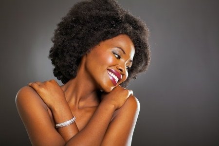smile close up: african american fashion woman student portrait on black