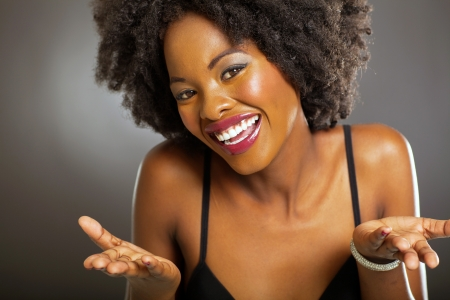 smiling women: cute african american woman on black background Stock Photo