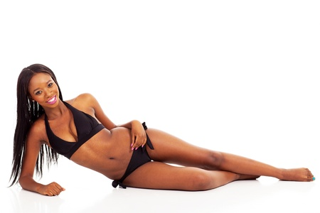 attractive african woman in bikini lying on white background photo