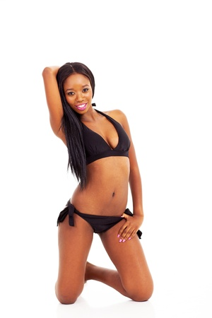cute african girl in bikini knee down on floor photo