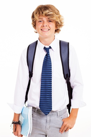handsome boy: cute teen boy studio portrait with books and backpack Stock Photo