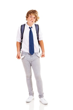broke: broke teen boy with no money and showing empty pockets Stock Photo