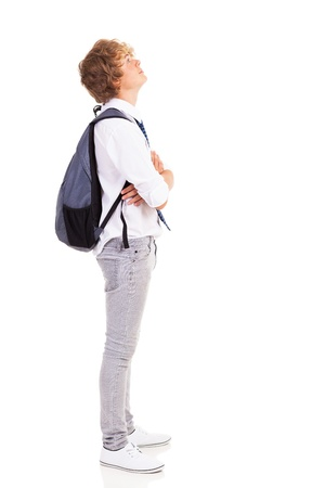 teen boy with backpack looking up photo