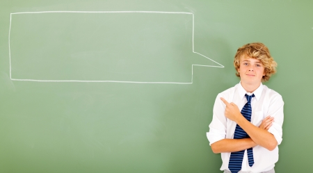 high school teen student pointing at chat box drawn on chalkboard photo