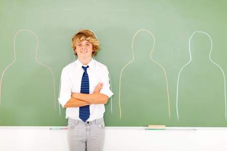 conceptual photo of high school teen boy standing in front of chalkboard next to body shapes photo