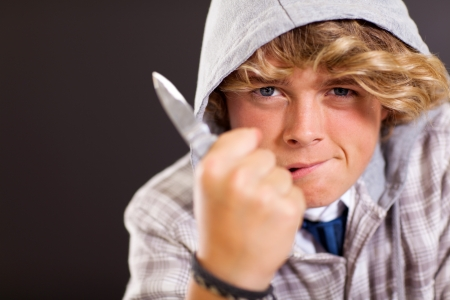 violent teen boy holding a knife photo