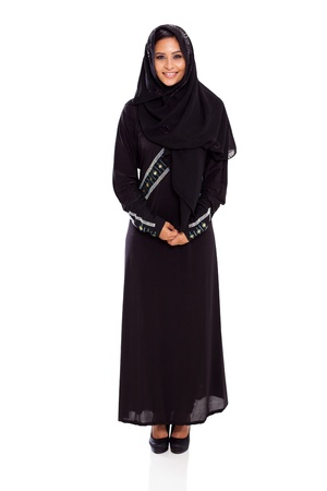 pretty young muslim woman full length studio portrait on white photo