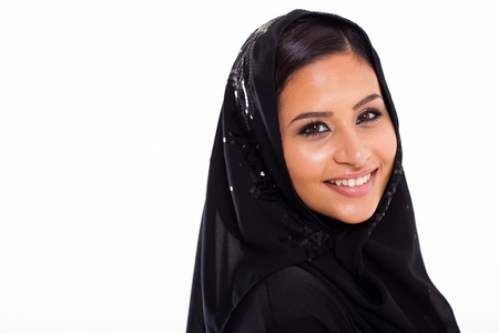 pretty young muslim woman head shot over white background photo