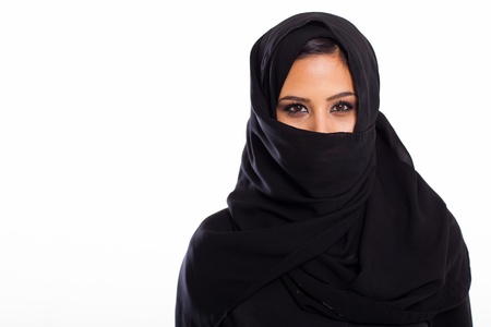 portrait of young muslim woman on white photo