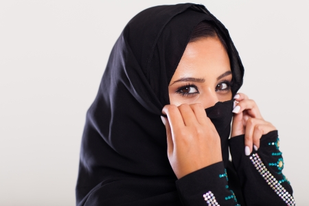 mysterious middle eastern woman closeup portrait photo