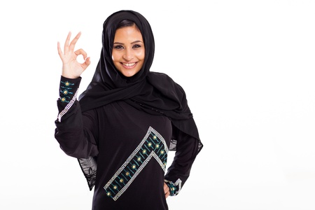 middle eastern woman: beautiful modern arabian woman giving ok hand sign