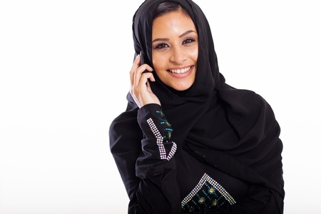 attractive modern muslim woman talking on cell phone photo