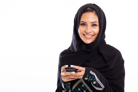 young Arabic woman with smart phone isolated on white