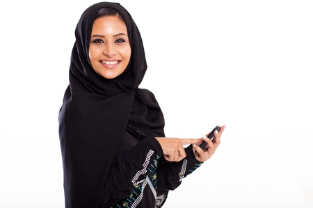 attractive middle eastern woman with smart phone isolated on white photo